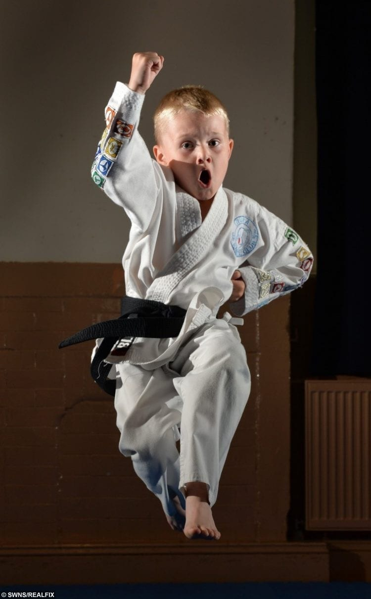 real life karate kid becomes youngest black belt in