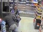 Brave Female Shop Worker Fights Off Armed Robber
