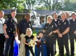 Adorable Six-Year-Old Lad Desperate To Be A Police Officer Set Up Stall Outside His House To Serve Lemonade And Donuts To Cops