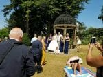 Shameless Sunbather Photobombs Happy Couple's Wedding Pictures