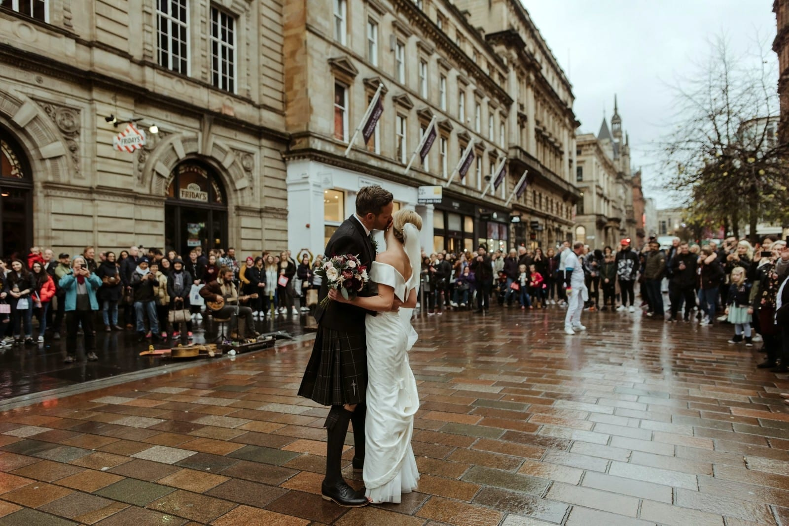 Newlyweds Brought Scotland's Busiest Street To A Standstill As They Enjoyed Their First Dance – Accompanied By Busker