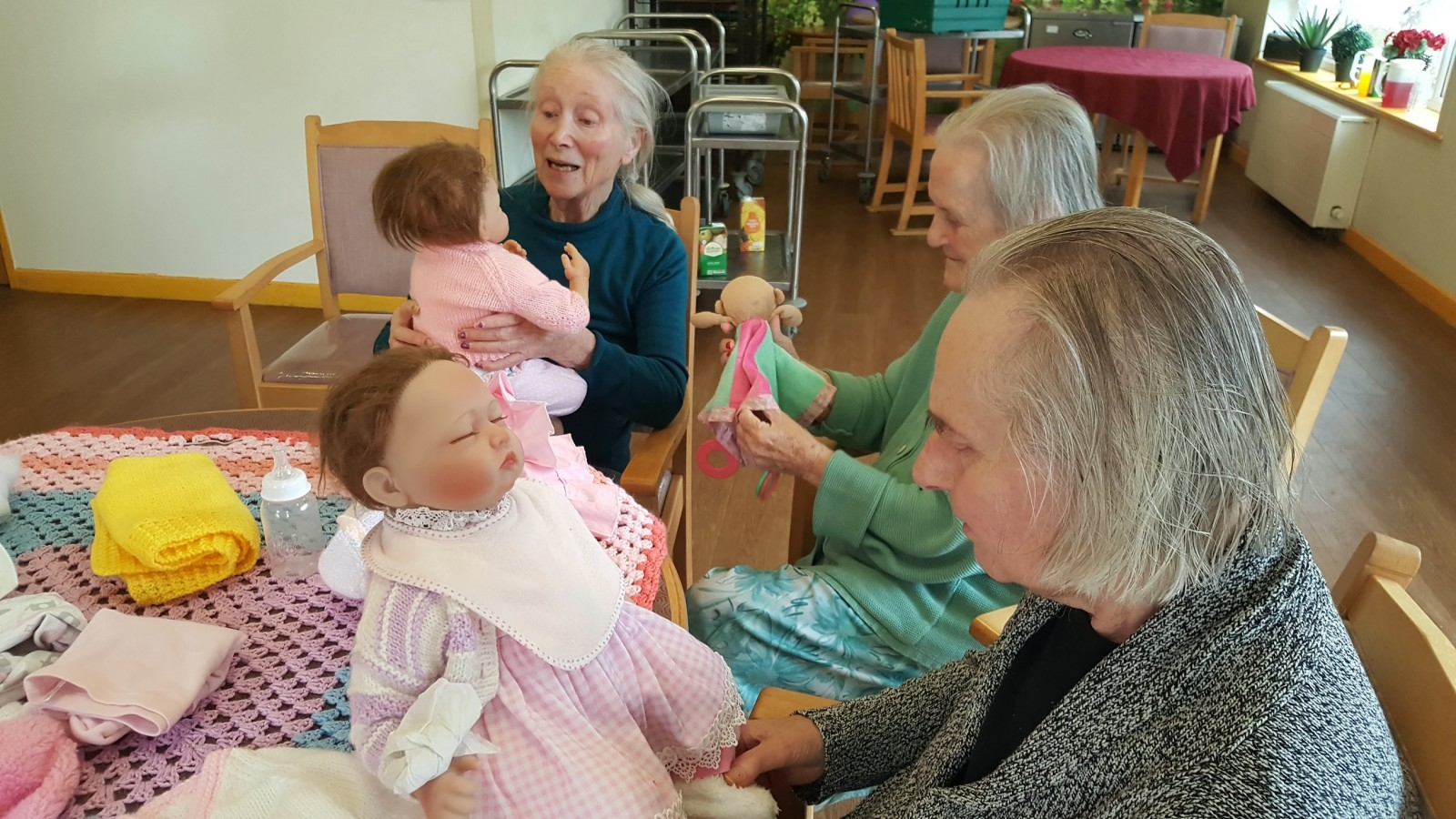Dementia Care Home Provides New Form Of Therapy For Residents - By Giving Them Baby Dolls To Look After