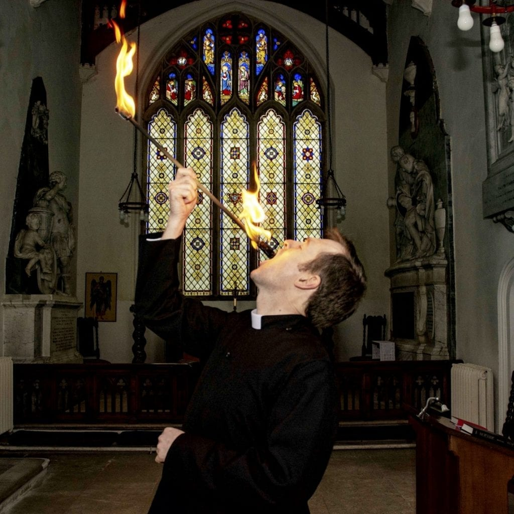 Daredevil Vicar Stuns Worshippers By Fire Eating In Church