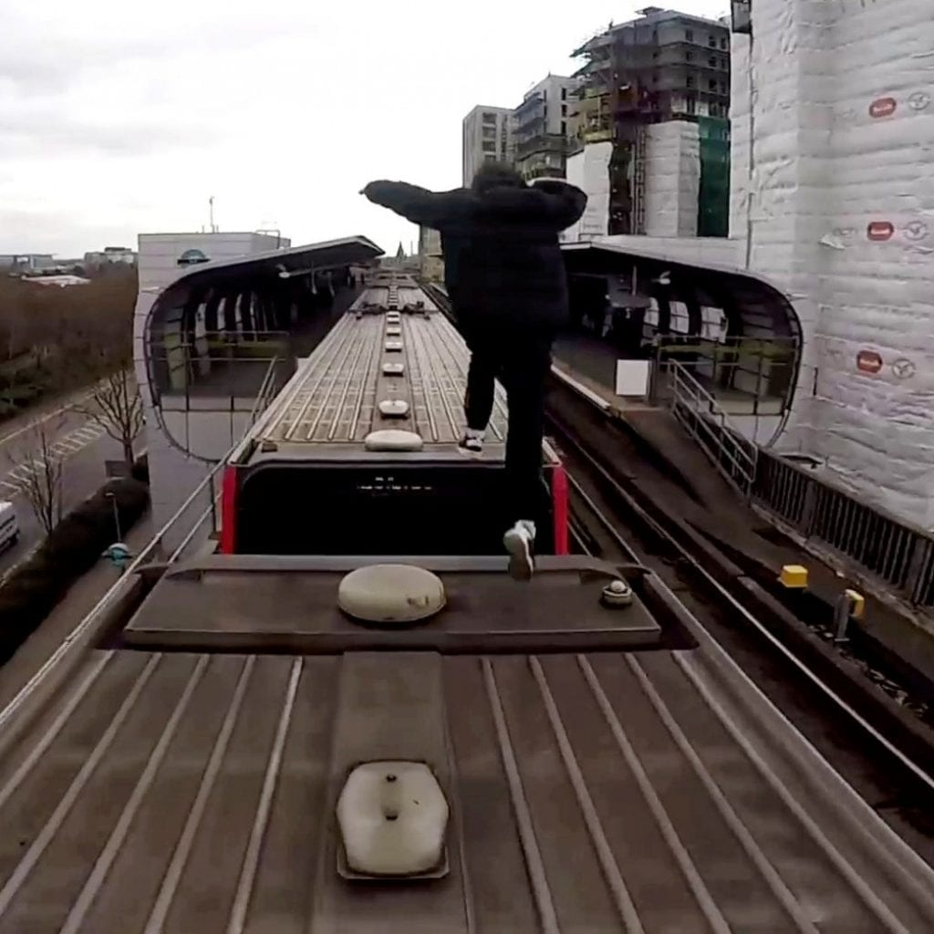Astonishing Moment Free Runners Ride On Top Of A TRAIN In London For A Stunt