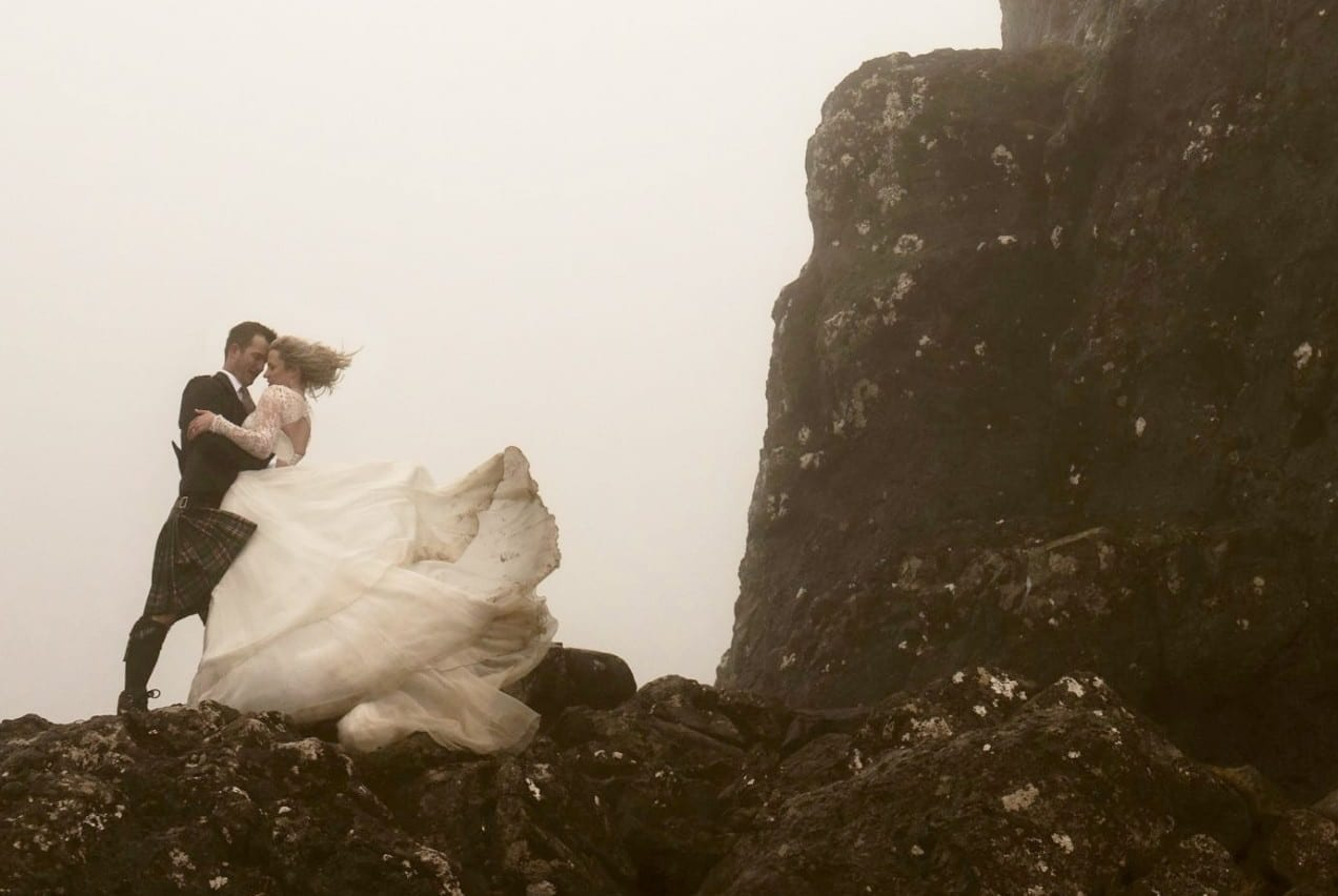 Newly-wed Bride Climbed A Massive Rock In The Mist In Her Wedding Gown – And Was Mistaken For A GHOST By French Tourists