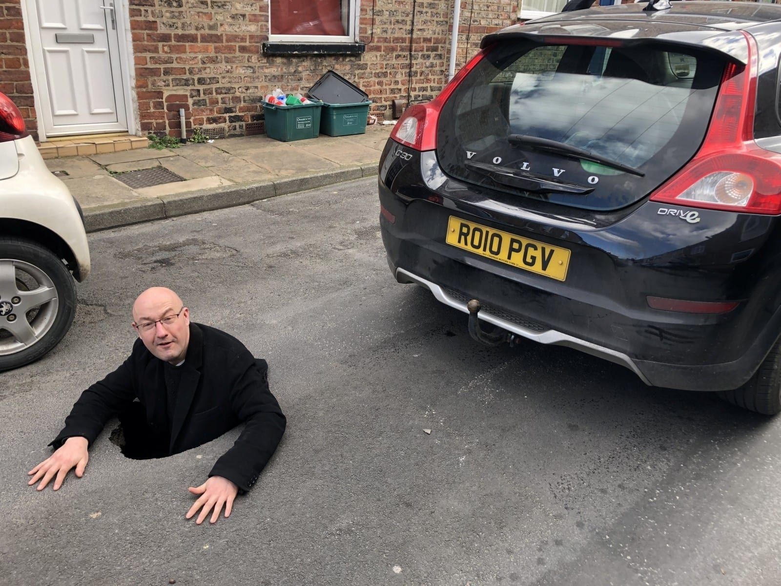 Motorist Plunged Into Four Foot Deep Pothole – Then Climbed Inside It