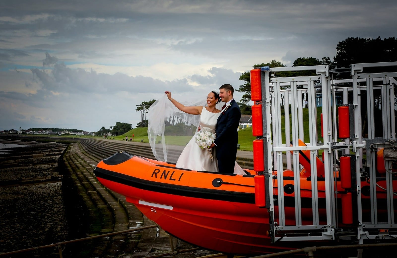 RNLI Volunteers Tied The Knot In Front Of Friends And Family - With The Groom Carrying On-Call Pager