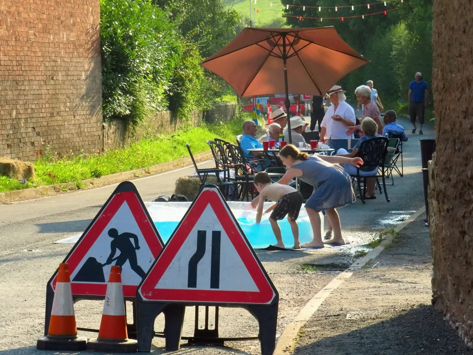 Villagers Driven Round The Bend By 26-mile Diversion After 50m Road Closed Cheer Themselves Up With Street Party On Shut Highway