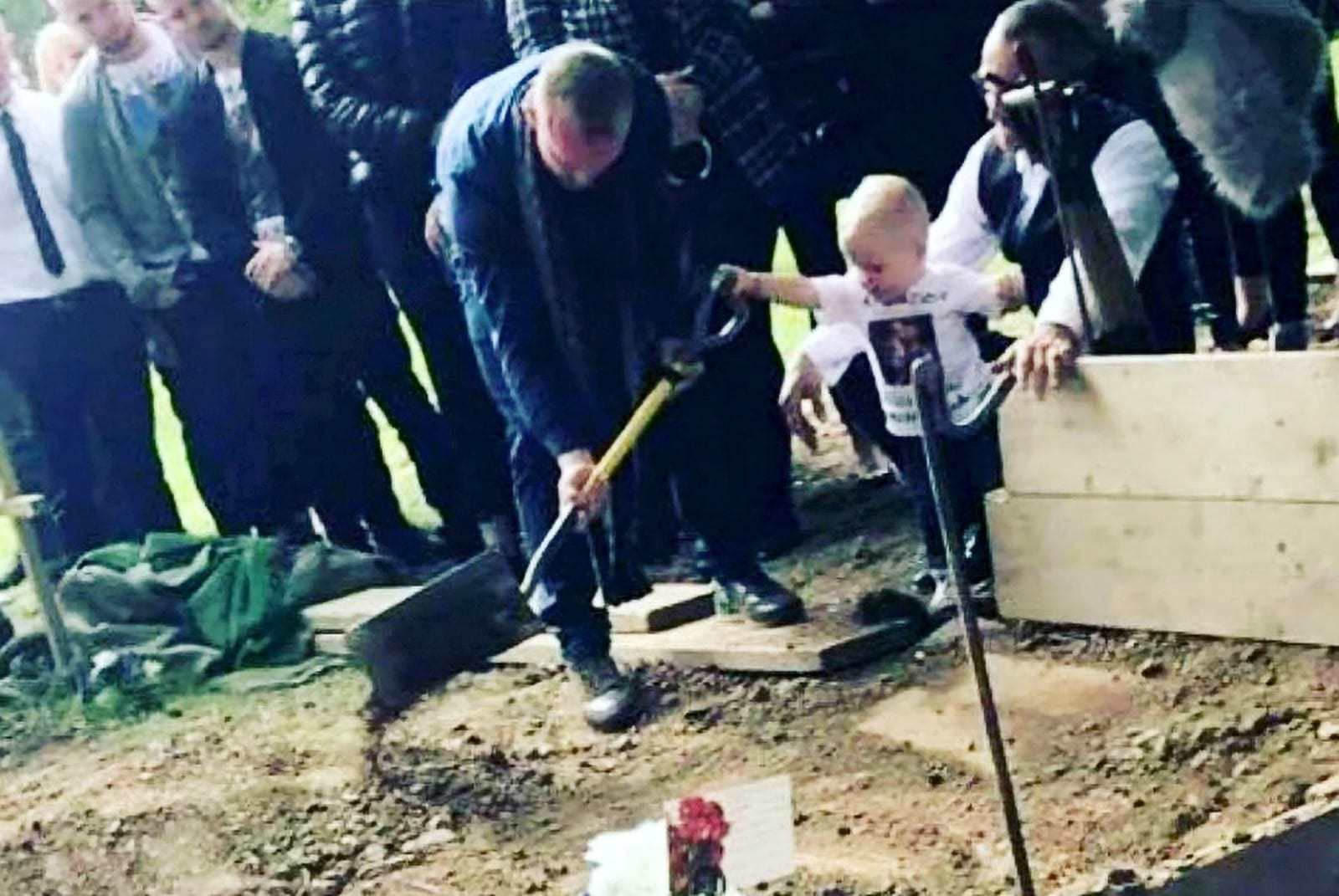 Heart-Wrenching Photo Of A Tiny 17-Month-Old Shovelling Soil Into His Daddy's Grave Has Been Released In A Bid To Prevent Knife Crime