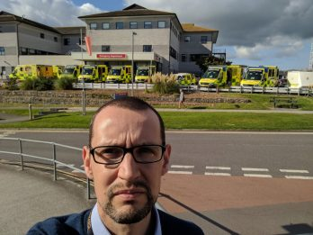 Ambulances Pictured Queuing Outside Overstretched Hospital As Patients Are Treated In Corridors And On The Vehicles