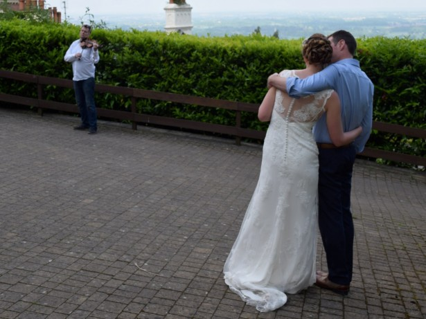 Bride and groom performed their first dance to music played by a BUSKER