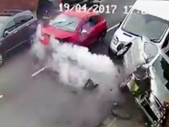 WATCH - Epic Car Smash Caught On CCTV Before Car Occupants Scarper With Their Dog!