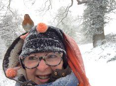 Cheeky Robin Photobombs Dog Walker's Snowy Selfie – Landing On Her Head