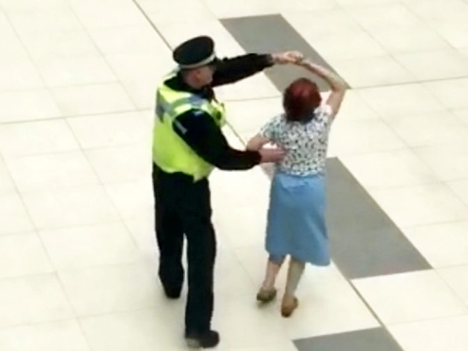 Heart-Warming Moment Police Officer Waltzes With Elderly Lady In A Shopping Mall