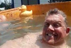 Builders Turn On Site Dumper Truck Into Mini Swimming Pool