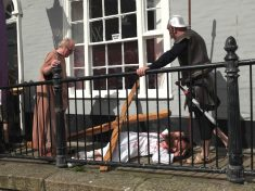 Easter Parade Goes Wrong As Jesus Smashes Bible Selling Shop Window With Crucifix