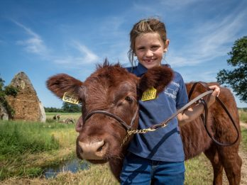 7-Year-Old Becomes Real-Life Cowgirl After Forming Unique Bond With Orphaned Calf Which She Hand-Reared From Birth