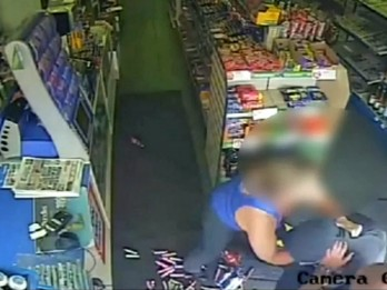 WATCH : Heroic shopkeeper tackles armed robber as he tries to nick till