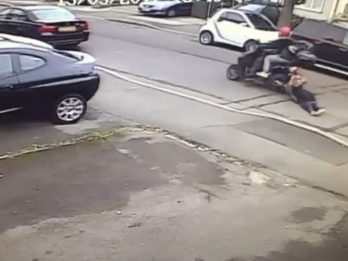 WATCH - Brave Woman DRAGGED Down Road By Moped Thieves