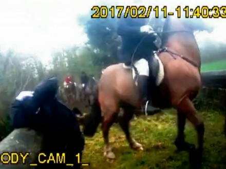 WATCH : Shocking Moment Huntsman Allegedly WHIPS Female Saboteur Over The Head