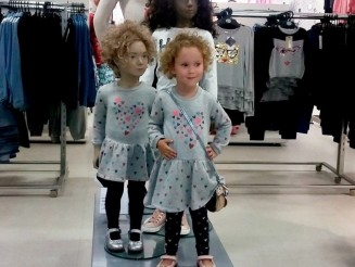 Adorable little girl finds her 'twin' in a M&S mannequin
