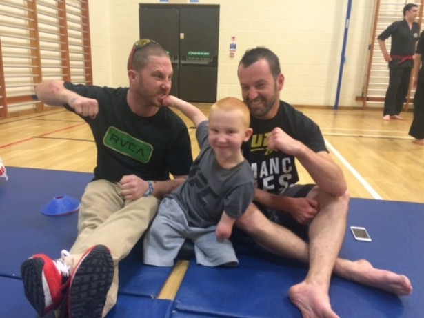 Young boy who lost four limbs to meningitis takes up martial arts!