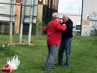 WATCH - Pensioners In Bare-Knuckle FIST FIGHT Outside Care Home Before One Helps The Other Look For His Glasses