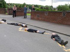 Kids Lie Across Street In Bizarre Attempt To Make Drivers Rethink Their Road Behaviour