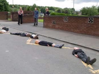 Kids Lie Across Street In Bizarre Attempt To Make Drivers Rethink Their Road Behaviour