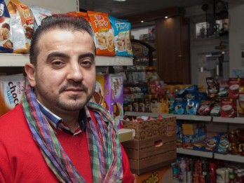 WATCH : Armed Robber Forced To Flee Empty Handed After Hero Shopkeeper Fought Him Off With DOG Repellent