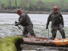 Dramatic Pictures Show Moment Dozy Father And Son Get Stuck In Mud Aboard Kayak For Several Hours