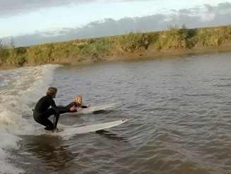 Heartwarming moment man proposes to his girlfriend - while surfing the Severn Bore