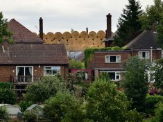 Wealthy Villagers Furious After Farmer Dumps 30ft High Stacks Of Hay Bales Outside Their £500,000 Homes