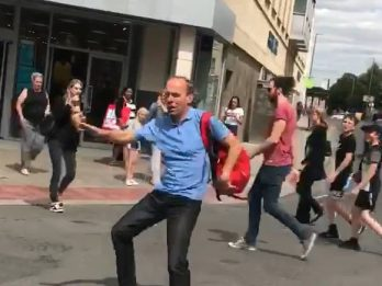 Hilarious Moment Man Who Didn't Have Any Change Showed Appreciation To Busker By Dancing Along Entire High Street