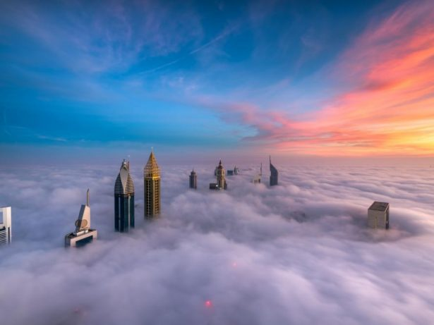 Real Estate Photographer Goes To Great Heights To Capture The Perfect Picture As Part Of His Job