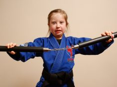 Inspiring Eight-Year-Old Who Has Down's Syndrome Receives Black Belt In MMA
