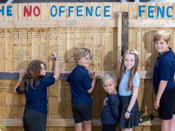 Woman Who Spots Vile Graffiti On Her Fence Turns It Into A 'No Offence Fence' - Inviting Kids To Write Positive Messages