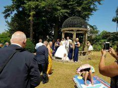 Shameless Sunbather Photobombs Happy Couple's Wedding Pictures