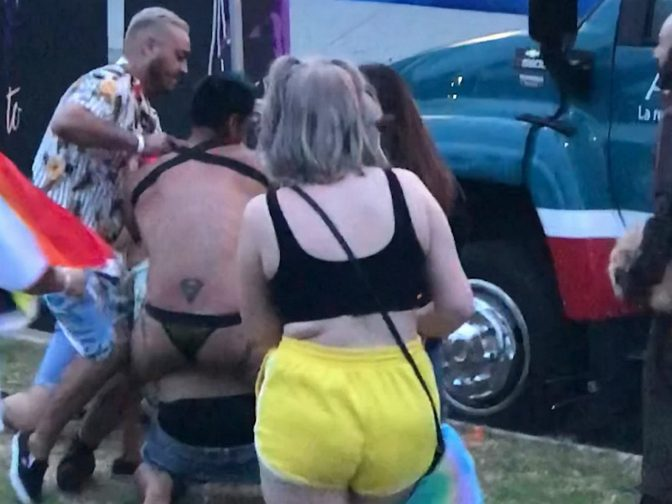 Bizarre Footage Shows Fist Fight Between Pink-Haired Man And Thong-Clad Fellow Reveller At Pride Festival