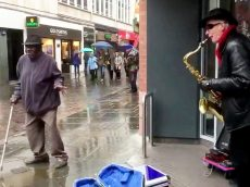 Disabled Man Ditches Walking Stick And Breaks Into Dance In Front Of Busker