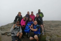 Determined Young Boy Reaches Top Of Munro In A Wheelchair