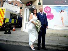 Newlyweds Pose For Photo Against Backdrop Of Huge Police Raid Which Saw Nearly 1,000 Cannabis Plants Discovered